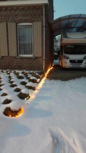 Kerstfoto lampjes sneeuw mobilhome